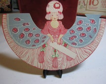 Colorful unused 1920's art deco die cut place card colonial girl with powdered wig peacock design dress p f volland