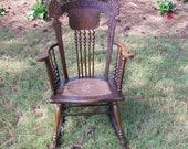 Beautiful Tiger Oak Rocker with Gargoyle Seat Ornate Pressed Back