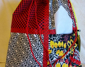 red and yellow on a yellow ripstop nylon drawstring backpack with front zipper pocket
