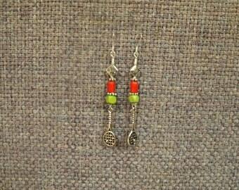 Tennis racquet dangle green and orange earrings