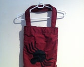 burgundy cotton tote with a black spider