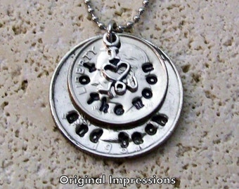 I love you to the moon and back coin pendant necklace. Dime and quarter U.S. coins with a sterling silver charm on a stainless steel chain.