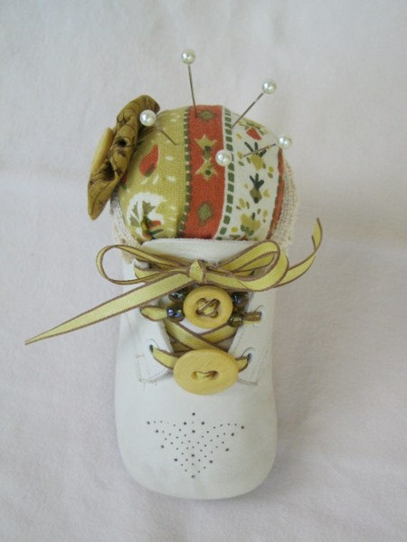 Leather baby shoe pin cushion with ribbon and beads