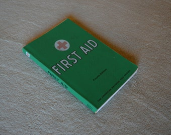1973 vintage FIRST AID text book, fourth edition, 41st printing