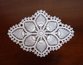 Small white oval pineapple crochet doily