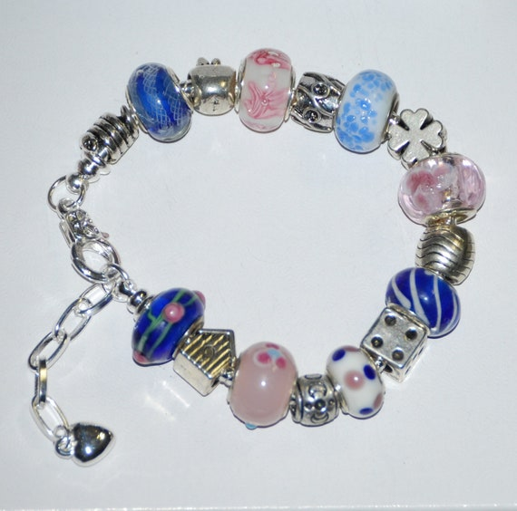 Lovely Pandora like European bracelet with pink and blue Murano beads plus adorable silver spacer charms.