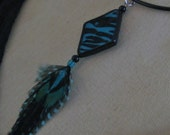 Polymer Clay Zebra Pendant Necklace with Black and Turquoise Feathers