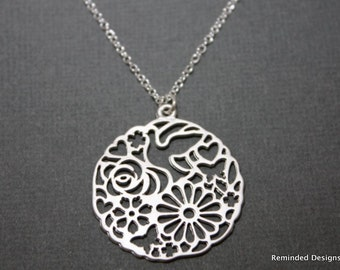 058- Spontaneity - Sterling silver round nature scene cutout necklace
