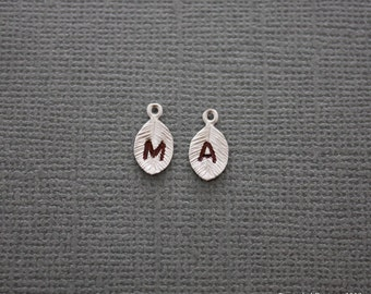 Personalize it with silver Stamped initial leaf
