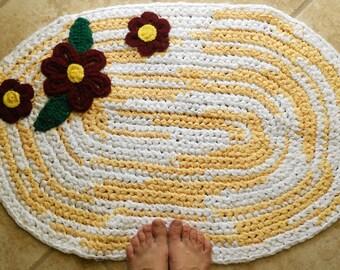 Oval Sunshine and Gerber daisies. Crocheted rag rug.