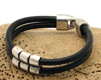 EXPRESS SHIPPING Men's leather bracelet. Black leather , multi strap men's bracelet with silver plated spacers and clasp .