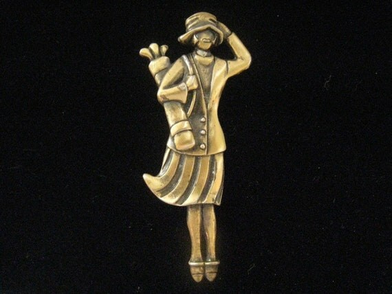 Vintage Brooch of Lady Golfer in Skirted Outfit with Hat Carrying Her Clubs by FORT