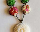 Cream flower necklace with fabric button and green resin flower accents-SALE