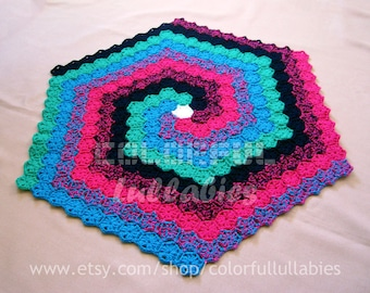 Crochet Hexagon Spiral Rug Pattern with continuous crochet technique. English and Spanish pattern. Motifs made without cutting the thread