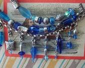 Charm Bracelet  Modern Twist Boho Avant Garde Sterling and Hill Tribes Silver Vintage Blue Glass Beads  Three Row I Got the Blues Adjustable