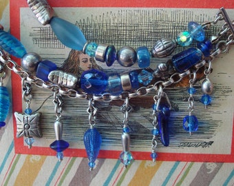 Charm Bracelet  Modern Twist Boho Avant Garde Sterling and Hill Tribes Silver Vintage Blue Glass Beads  Three Row I Got the Blues Adjustable