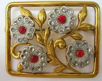 Large rectangular framed old gold pin with four flowers