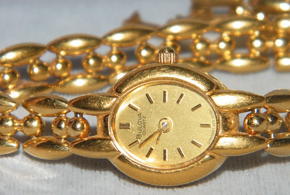 Ladies Bulova Quartz T2 Gold Tone Stainless Steel Water Resistant Germany Watch