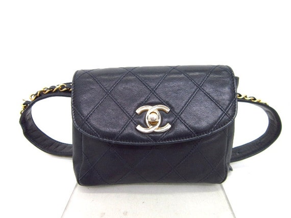 80s Vintage CHANEL navy waist purse with golden chain belt.