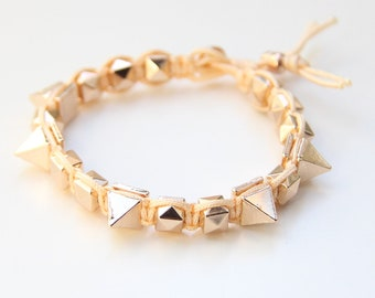 on sale! Arm candy - Gold Spikes beads and Peach cord - woven bracelet