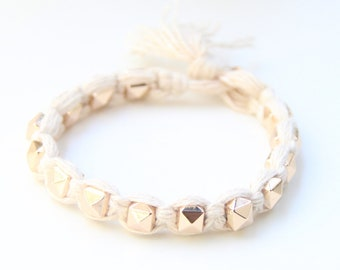 on sale! Arm candy - Gold pyramid beads and White cord - woven bracelet