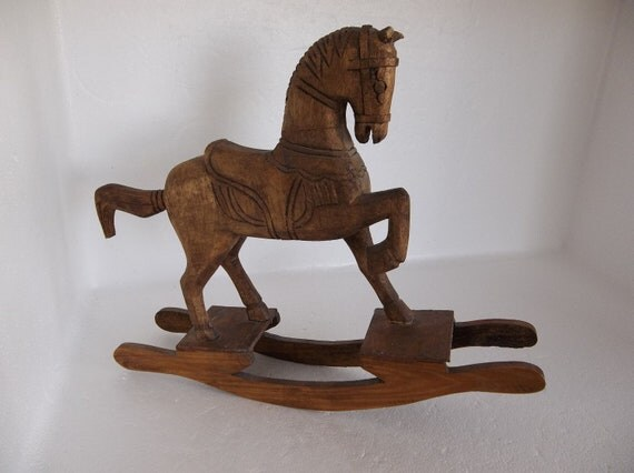 Vintage Handcrafted Brown Wooden Rocking Horse with an Aged Antique Look.