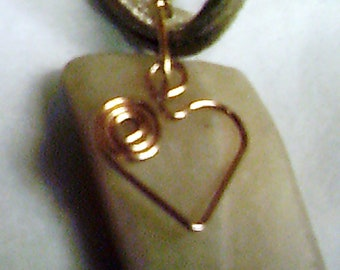 Gold corded ribbon necklace with creamy natural stone drop & gold wire heart. Alenna's Heart 2 Heart Charity