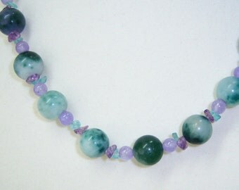 Ching Hai Jade of green, white, lavender with amethyst n&e.