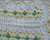 """delicate and intricately hand knit 44"""" x 40"""" approximate white, pale yellow and green flower patterned baby afghan or table cloth with scall"""
