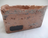 Terracotta tinted rectangular cement planter with accent glass tiles