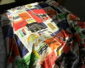 Vintage used Twin fitted sheet printed with Jurassic Park dinosaurs and LOGO