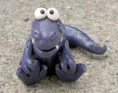 Dark purple T-Rex grabbing toes