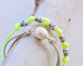 Stacked bracelets set of two - neon yellow bracelet with silver skull charms and silver leather bracelet with fresh water pearl -BlackOrchid