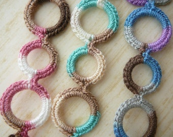 Baby pacifier clip, crochet, circles- Newest style - (universal, fits mam, soothie, nuk)  Made by lippy brand.