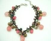 Drop cherry quartz hand-knotted on wax cotton bracelet.