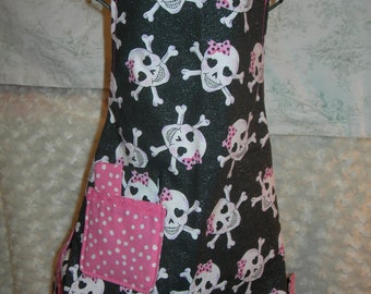Girls reversible apron in Sparkly Skulls with Pink Bows and Dots, ready for those baking dates, Shine On