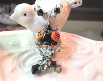 Necklace black orange glass lampwork bead and crystals