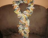 Hand knitted scarf using - Sundance Frill Mesh Yarn- Jack- O- Lantern