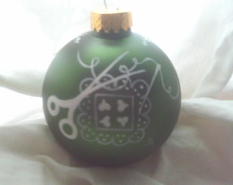 Handpainted quilt on A Christmas ball