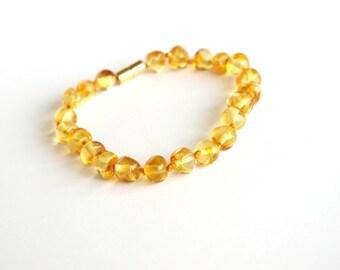 Elegant Baltic Amber Bracelet. Lemon color amber beads with magnetic clasp
