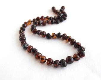 Elegant Baltic amber necklace. Dark cognac color amber beads