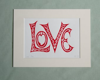 Print - 'Love'.  Red (or black) on white, block print of the word LOVE.