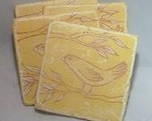 Rustic yellow bird tile coasters