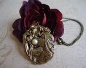 Art Nouveau pendant necklace in antiqued brass