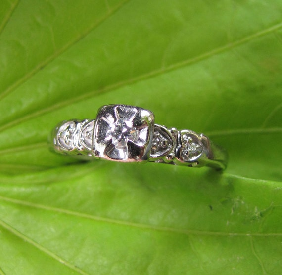 Queen of Hearts : 1950's White Gold and Diamond Illusion Head Engagement Ring with 4-Heart Motif,  size 6