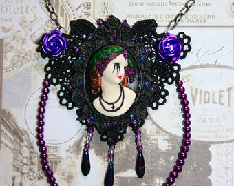 3D cameo on black lace with metallic purple beads and roses.