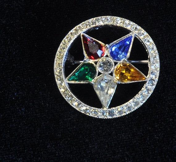 Eastern Star ORA  Brooch Pin, ORA brand vintage brooch pin, multi colored rhinestones star pin within a circle of crystal rhinestones,