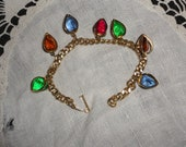 vintage gold tone bracelet with WRAPPED HEART  charms