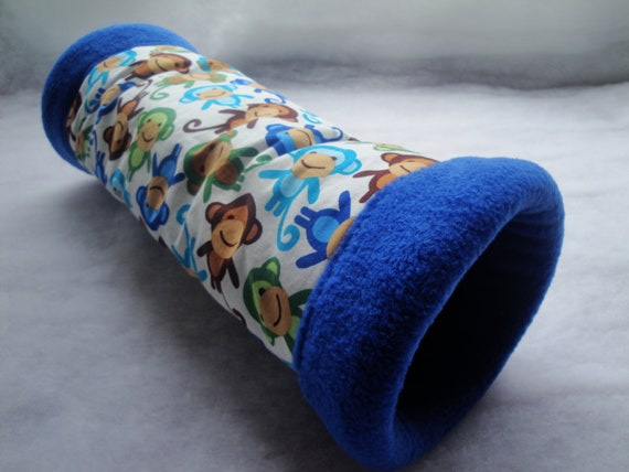 Plush fabric tunnel for guinea pigs with funky monkey design and super soft royal blue fleece