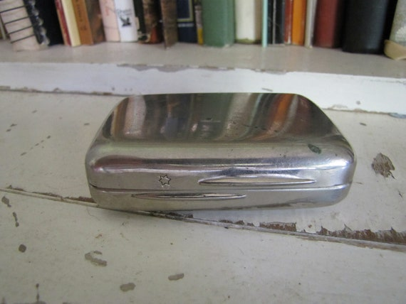 vintage silver toned metal container cigarette, stash box, or pill box engraved with a star
